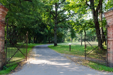 large antique gate open into the park