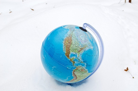 snowbank: earth globe sphere lie stand in winter snow snowbank