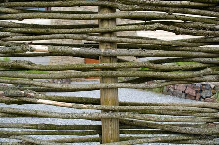 poling: closeup wicker weave wooden twig fence background