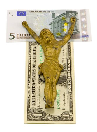 crucify: gold jesus crucify on euro and dollar banknotes isolated on white concept of world finance crisis ten euro and one dollar banknotes