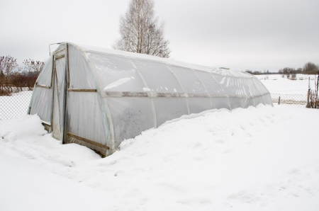 polythene: diy homemade greenhouse covered with polythene and snow in winter