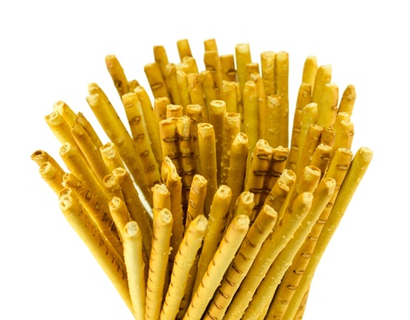 salty sticks snap to beer food closeup isolated on white background.  photo