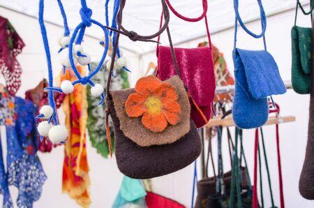 colorful felt wool girl bags sold in outdoor street market fair