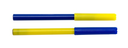 felt tip pens with different blue yellow color plugs caps isolated on white.  photo