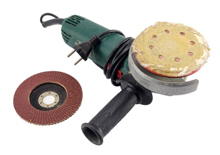 electric sander grinder tool with worn sandpaper head and new head isolated on white background.  Stock Photo