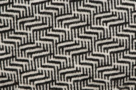 hand knit wool zigzag pattern texture black white backdrop.  photo