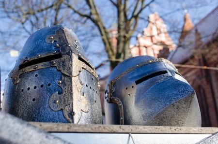 imitations: metal medieval ancient knights warrior helmets imitations sold in outdoor street market fair.  Stock Photo