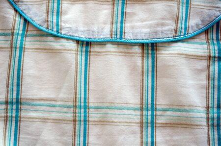 closeup crumple fabric green square shape texture background.  photo
