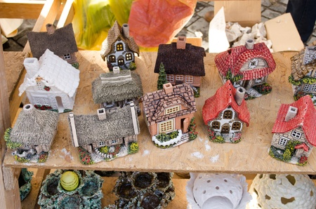 handmade craft decor clay houses sell in outdoor street fair market event.  photo