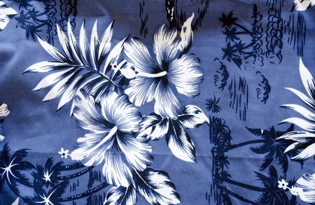 shorts bathing trunks background with blue white topical flowers and palms closeup.