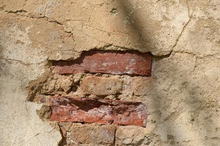 requires: vintage damaged grunge brick wall requires repair background.  Stock Photo