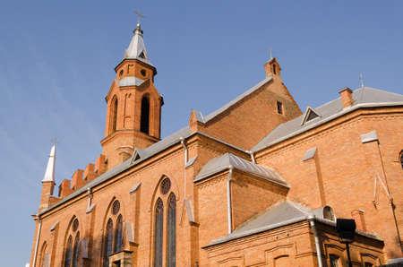 Iglesia g�tica con cruces y ventanas en arco sobre fondo azul cielo photo