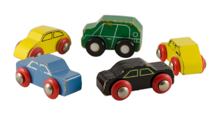 retro wooden colorful cars toy standing in circle isolated on white background  photo