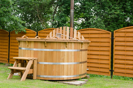 modern new wooden water spa hot tub with stairs outdoor  Stock Photo
