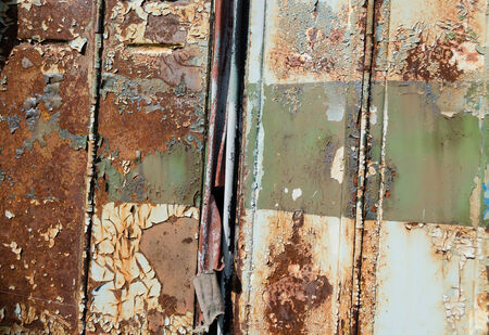 close up of old cracked rusty metal bus door background Stock Photo
