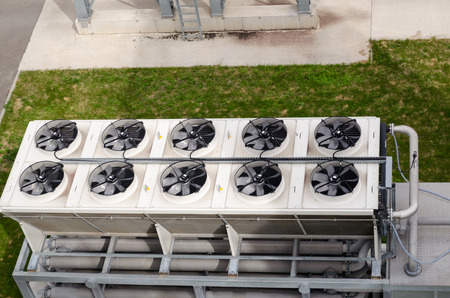 Ventilator fan spin on industrial building of biogas bio gas plant. Alternative energy process from water treatment facility sludge.