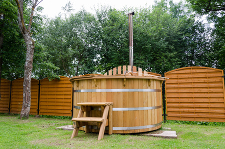 rustic wooden water spa hot tub with stairs in garden yard  photo