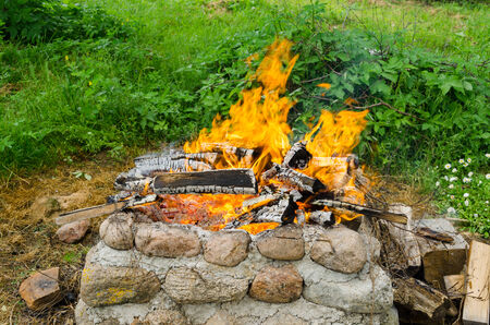 fireplaces: stone wall fireplaces a nice quiet burn firewood  Stock Photo