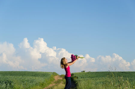 happy girl bask the summer stillness of nature and flowers  Stock Photo