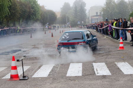 SIRVINTOS, LITHUANIA - SEPTEMBER 29: car ride in the slalom competition in city street on September 29, 2013 in Sirvintos, Lithuania.