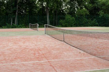 tennis courts in recreation village park in summer nature