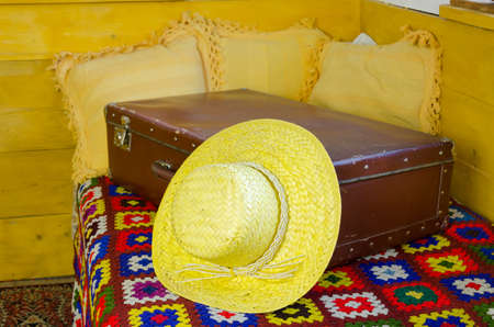 close up of summer straw women hat on old rustic suitcase  Stock Photo