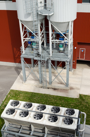 Ventilator cooler fan spin on industrial building of biogas bio gas plant. Alternative energy process from water treatment facility sludge.