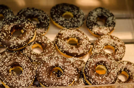 fatty delicious donut with chocolate icing and sprinkles  Stock Photo