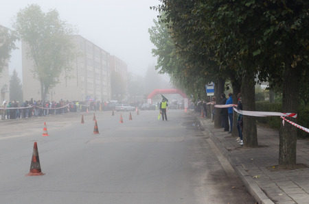slalom trail marked with orange towers in the thick fog  photo