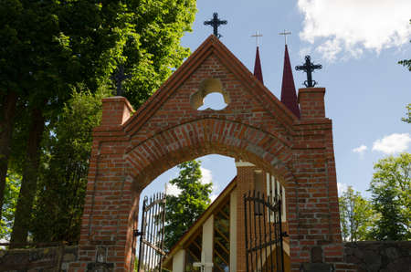 gothic church entrance door with crosses in summer time  photo
