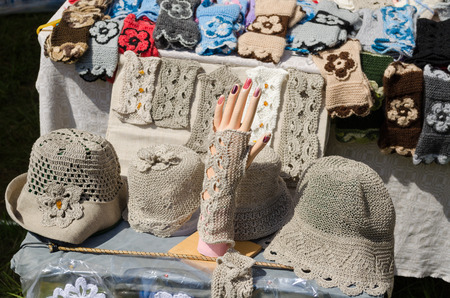 wristlets: female linen hats and wristlets crocheted at market trade