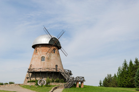 big old retro brick mill with stairs on the summer forest background  Stock Photo