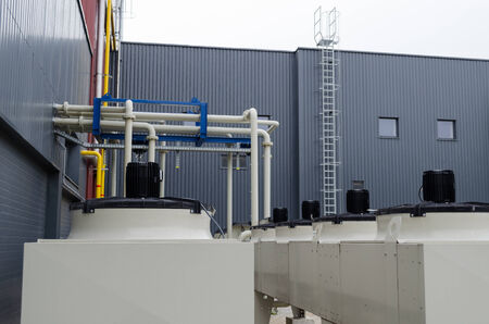Huge industrial engines used for generating biogas from sewage water treatment silt remains.