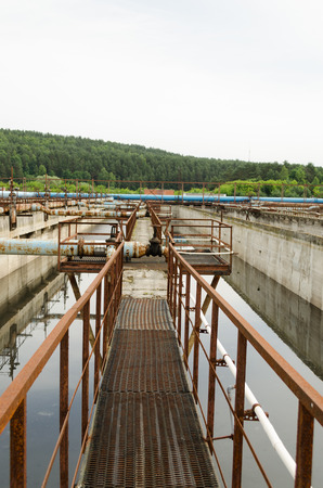 grit: Aeration process of waste sewage water treatment plant. Huge basin with bubbling dirty water. Aerotank grit chamber stage.  Stock Photo