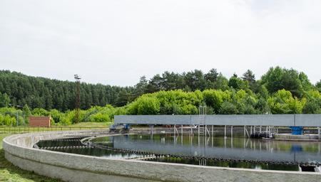 Reservoir of cleaned sewage water clarification step in treatment waterworks. Birds swim.