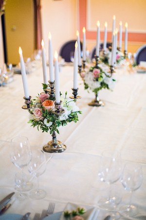 festiva: candlesticks with candles at a wedding adorned with peonies
