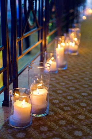 floor standing: large candles in glass jars standing on the floor