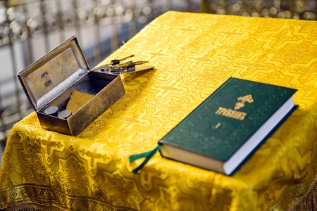 baptism of jesus: Church supplies priest for baptism on the table