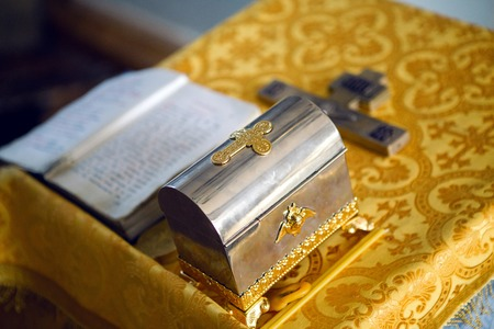 bible altar: Church supplies priest for baptism on the table