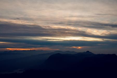 pada: sunrise in the mountains at the peak of Adam Stock Photo