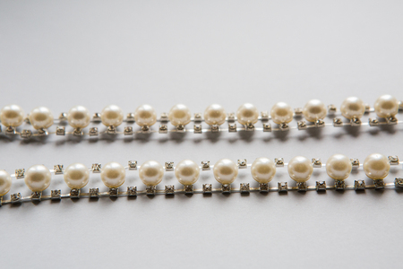 sewn: sewn white and silver thread with beads pearls Stock Photo