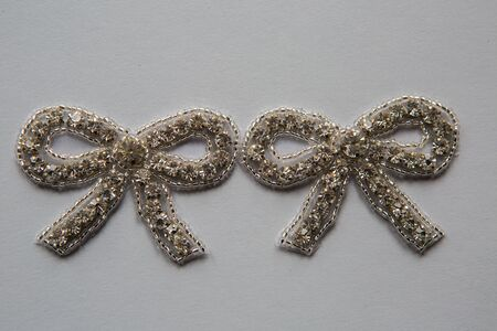 beaded: flatback bows and beaded white mesh for decoration of dresses for holiday
