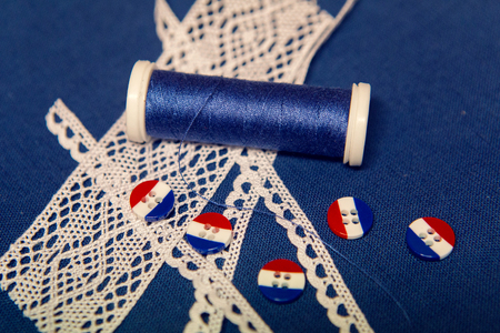 workpiece: the hardware or workpiece for the sewing of clothes. blue cloth, flax , thread, striped buttons