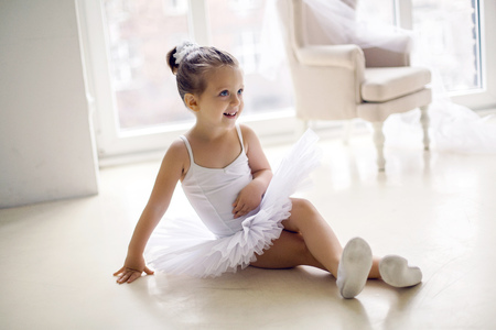 little ballerina girl 2 years in the Studio in a white tutu dress clothes 写真素材