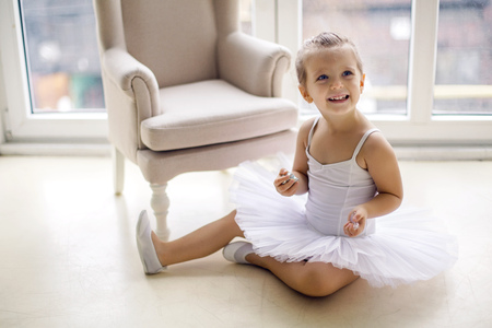 little blonde girl: little ballerina girl 2 years in the Studio in a white tutu dress clothes Stock Photo