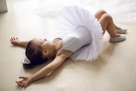 tutu: little ballerina girl 2 years in the Studio in a white tutu dress clothes Stock Photo