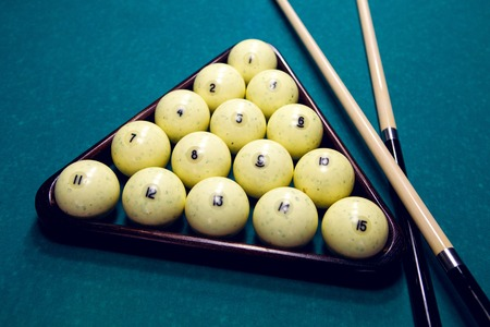 cue: white balls for Billiards in a triangle and two cue Stock Photo