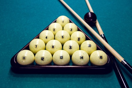cue: white balls for Billiards in a triangle and two cue and black ball
