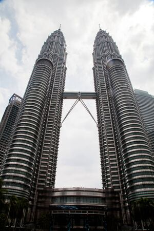 ammonium: KUALA LUMPUR, MALAYSIA - January 23 : The Petronas Towers, also known as the Petronas Twin Towers, KLCC are twin skyscrapers in the feast of the monk Ammonium on January 23, 2014.