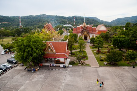 chalong: Phuket, Thailand - December 21 : temple Wat Chalong built in 1809-1824 , the view from the observation deck on large property with lawns and pools on the Day of St. Lucia in December 21, 2012.